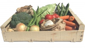 A wooden Box full of seasonal local vegetables