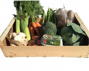box containing local vegetables and eggs