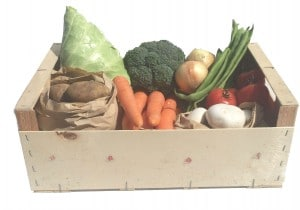 Wooden Box containing seasonal local vegetables