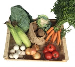 Wooden box containing local seasonal vegetables