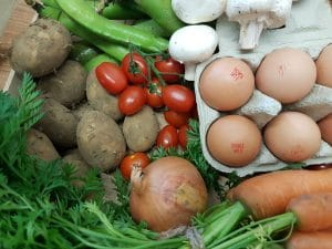 Photo of the contents of a small veg box.