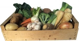 wooden box full of seasonal vegetables